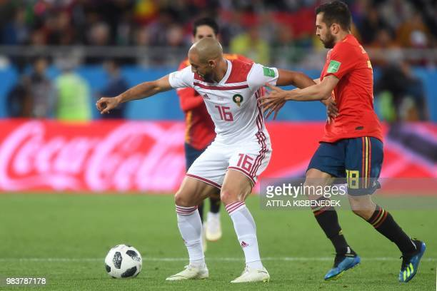 Spain's defender Jordi Alba vies with Morocco's forward Noureddine Amrabat during the Russia 2018 World Cup Group B football match between Spain and...