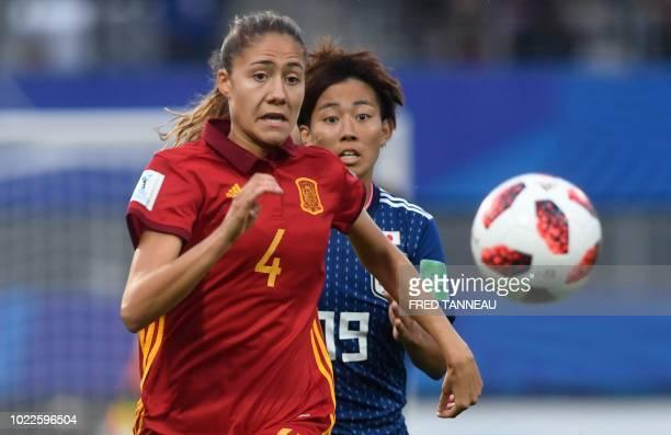 Spain's defender Laia Aleixandri vies with Japan's forward Riko Ueki during the Women's U20 World Cup final football match between Spain and Japan on...
