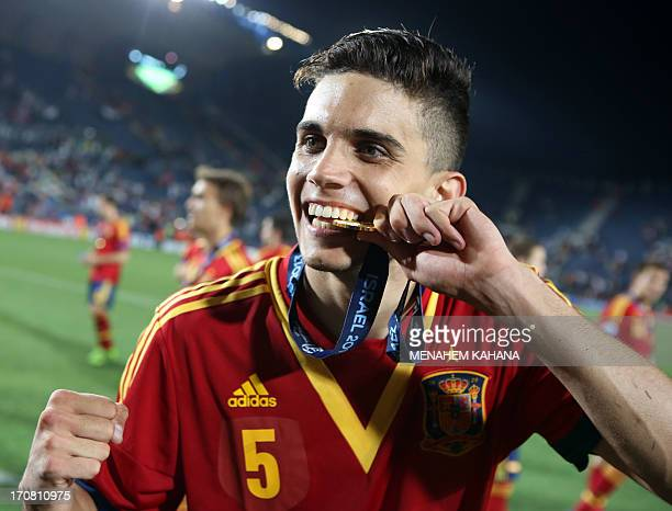Spain's defender Marc Bartra celebrates with his medal after beating Italy in their 2013 UEFA U21 Championship final football match at Teddy Stadium...