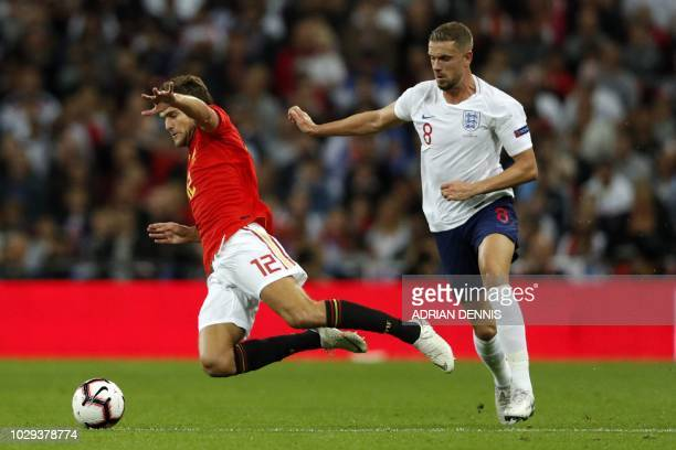 Spain's defender Marcos Alonso is fouled by England's midfielder Jordan Henderson during the UEFA Nations League football match between England and...