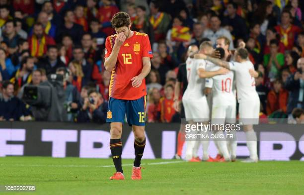 Spain's defender Marcos Alonso reacts after England's forward Marcus Rashford scored a goal during the UEFA Nations League football match between...
