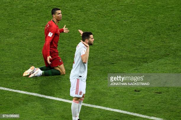 Spain's defender Nacho Fernandez gestures next to Portugal's forward Cristiano Ronaldo after a fault was called during the Russia 2018 World Cup...