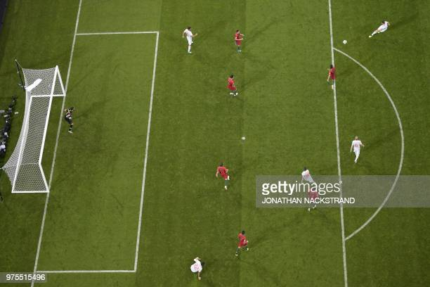 TOPSHOT Spain's defender Nacho Fernandez scores a goal during the Russia 2018 World Cup Group B football match between Portugal and Spain at the...
