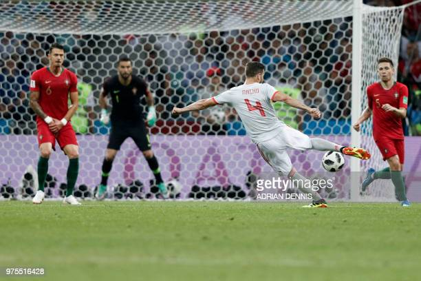 Spain's defender Nacho Fernandez shoots to score his team's third goal during the Russia 2018 World Cup Group B football match between Portugal and...