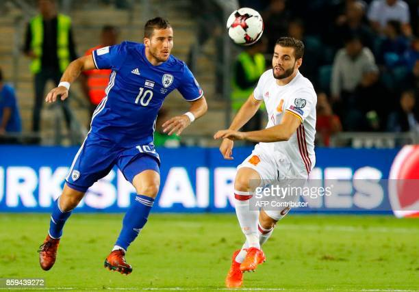 Spain's defender Nacho Fernandez vies for the ball with Israel's forward Tomer Hemed during the Russia 2018 FIFA World Cup European Group G...