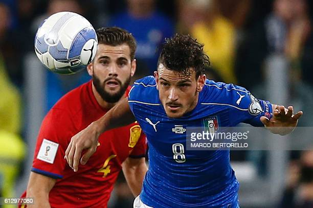 Spain's defender Nacho vies with Italy's midfielder Alessandro Florenzi during the WC 2018 football qualification match between Italy and Spain on...
