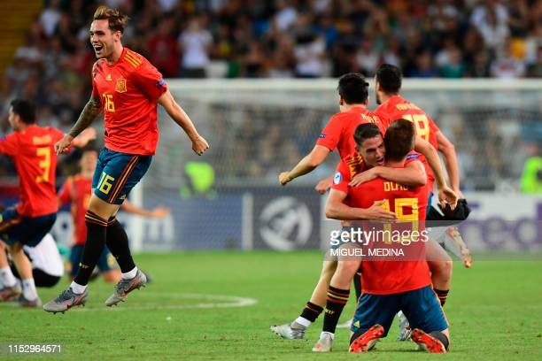 Spain's defender Pol Lirola and teammates celebrate at the end of the final match of the UEFA U21 European Football Championships Spain vs Germany on...