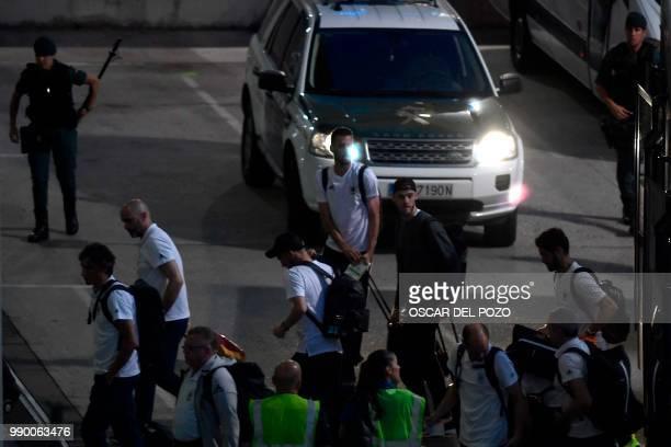 Spain's defender Sergio Busquets Spain's goalkeeper David de Gea and Spain's midfielder Isco arrive at Barajas Adolfo Suarez international airport in...
