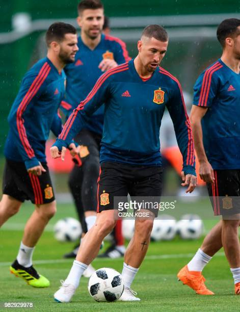 Spain's defender Sergio Ramos and his teamates take part in a training session at Mirniy Stadium in Kaliningrad on June 24 2018 on the eve of their...