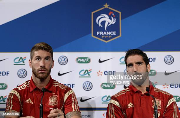 Spain's defender Sergio Ramos and midfielder Raul Garcia give a press conference on September 3 on the eve of the team's friendly football match...