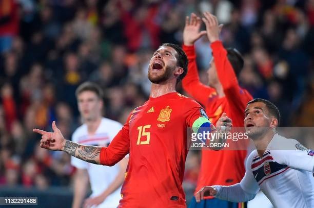 Spain's defender Sergio Ramos and Norway's defender Omar Elabdellaoui eye the ball during the Euro 2020 group F qualifying football match between...