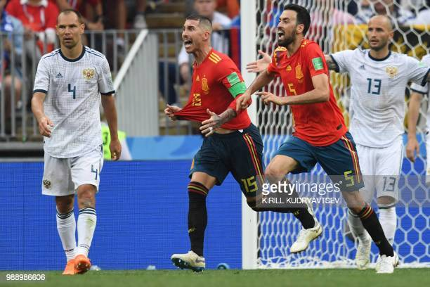 Spain's defender Sergio Ramos and Spain's midfielder Sergio Busquets appeal for a penalty during the Russia 2018 World Cup round of 16 football match...