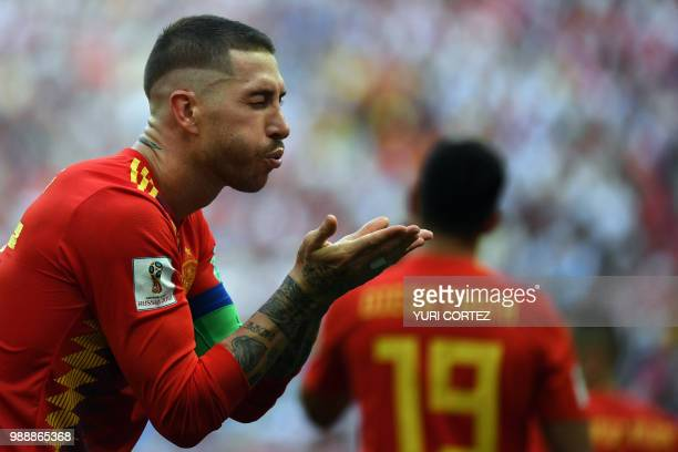 TOPSHOT Spain's defender Sergio Ramos blows a kiss as he celebrates after an own goal by Russia's defender Sergey Ignashevich during the Russia 2018...