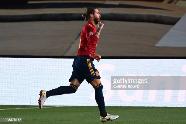 Spain's defender Sergio Ramos celebrates after scoring a second goal during the UEFA Nations League A group 4 football match between Spain and...