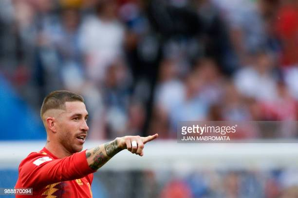 Spain's defender Sergio Ramos celebrates Russia's own goal during the Russia 2018 World Cup round of 16 football match between Spain and Russia at...
