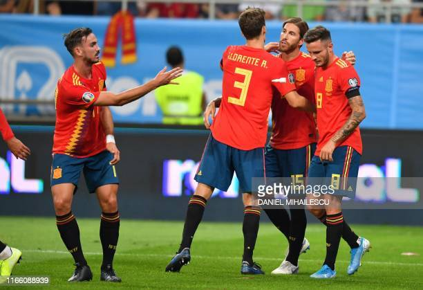 Spain's defender Sergio Ramos celebrates scoring with his teammates during the Euro 2020 football qualification match between Romania and Spain in...