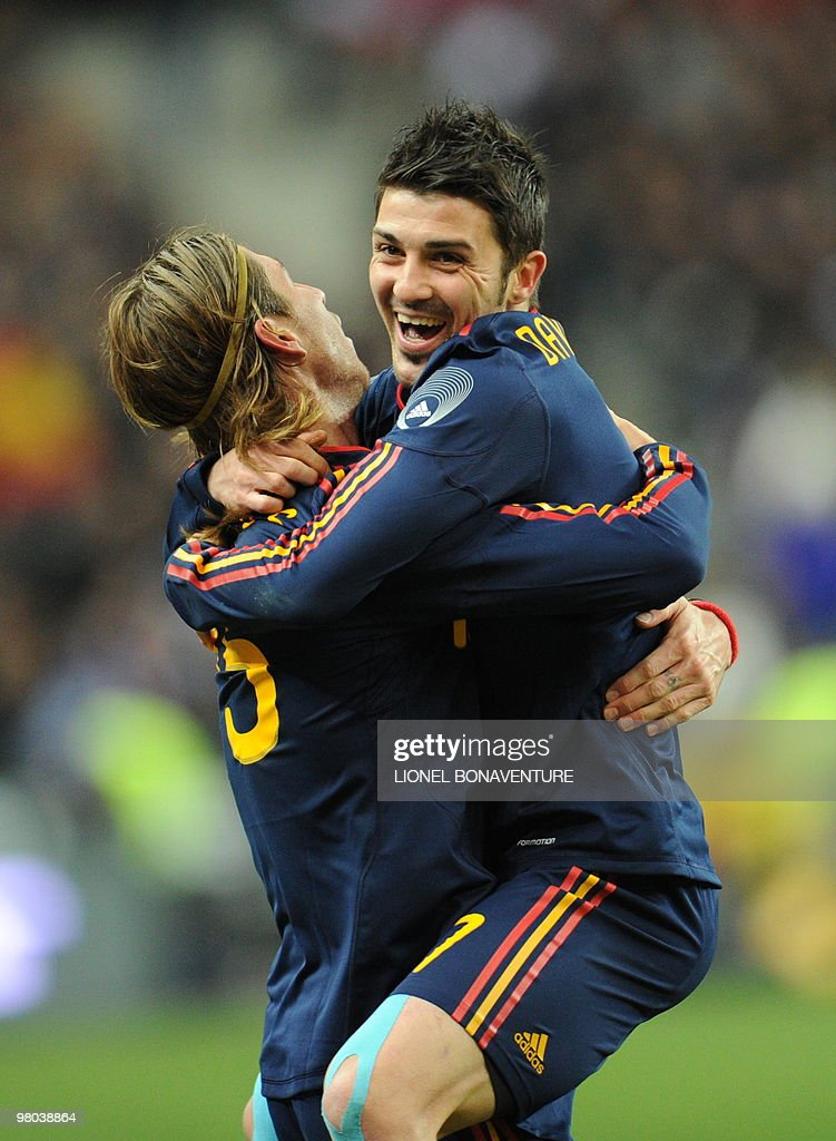 Spain's defender Sergio Ramos (L) celebrates with David Villa after scoring against France during a friendly international football match at the stade de France in Paris on March 3, 2010.
