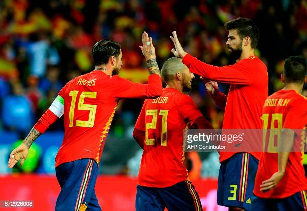 Spain's defender Sergio Ramos celebrates with Spain's defender Gerard Pique after Spain's forward Alvaro Morata scored a goal during the...