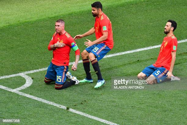 Spain's defender Sergio Ramos celebrates with Spain's forward Diego Costa and Spain's midfielder Sergio Busquets after Russia scored an own goal...