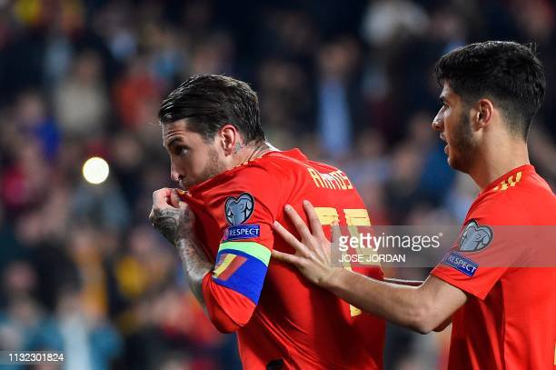 Spain's defender Sergio Ramos celebrates with Spain's midfielder Marco Asensio after scoring a goal during the Euro 2020 group F qualifying football...