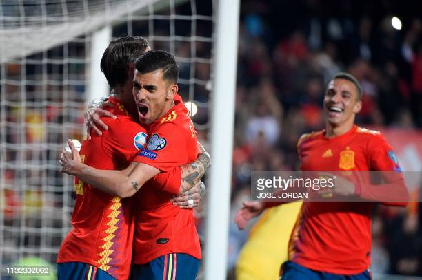 Spain's defender Sergio Ramos celebrates with Spain's midfielder Marco Asensio after scoring during the Euro 2020 group F qualifying football match...