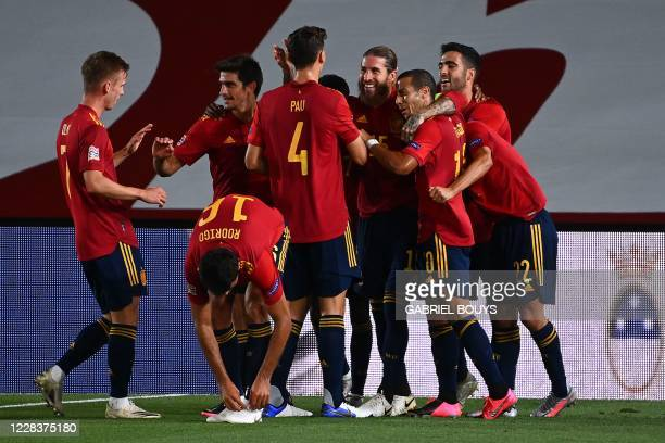Spain's defender Sergio Ramos celebrates with teammates after scoring a second goal during the UEFA Nations League A group 4 football match between...