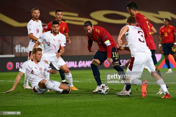 Spain's defender Sergio Ramos challenges Switzerland's players during the UEFA Nations League A group 4 football match between Spain and Switzerland...