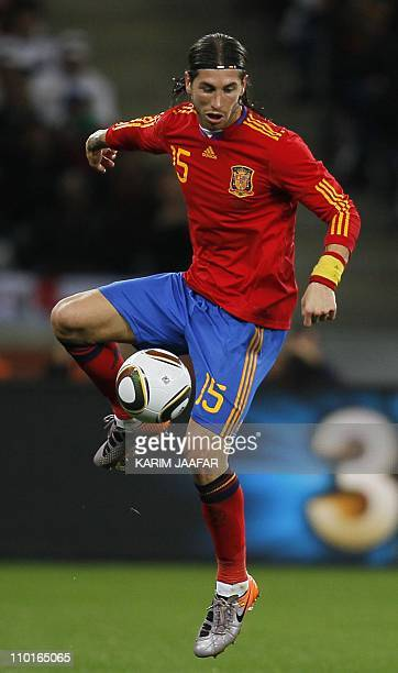 Spain's defender Sergio Ramos controls the ball during the 2010 World Cup round of 16 football match Spain vs. Portugal on June 29, 2010 at Green...