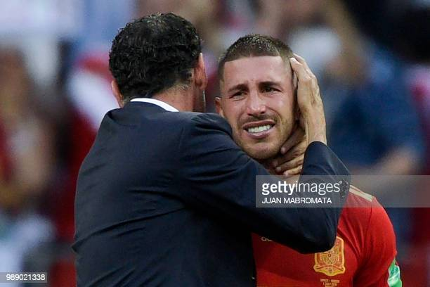 Spain's defender Sergio Ramos cries as Spain's coach Fernando Hierro comforts him after loosing the penalty shootout of the Russia 2018 World Cup...