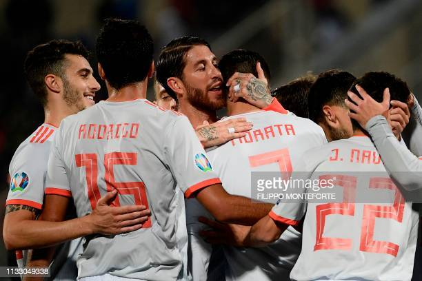 Spain's defender Sergio Ramos embraces Spain's forward Alvaro Morata after he scored during the Euro 2020 Group F qualifying football match Malta vs...