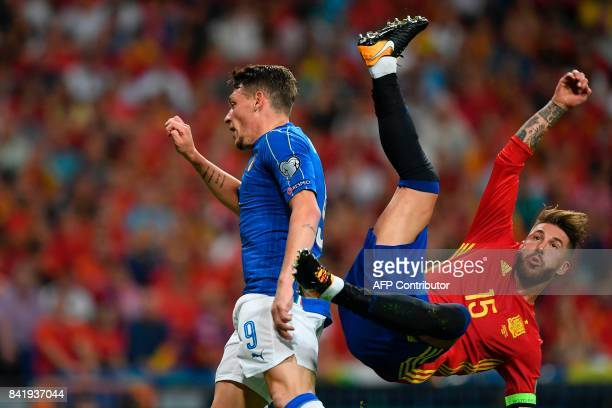 TOPSHOT Spain's defender Sergio Ramos falls past Italy's forward Andrea Belotti during the World Cup 2018 qualifier football match Spain vs Italy at...