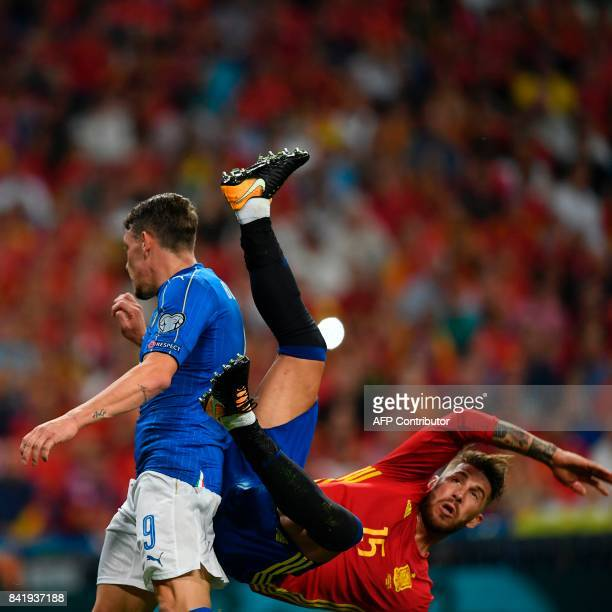 Spain's defender Sergio Ramos falls past Italy's forward Andrea Belotti during the World Cup 2018 qualifier football match Spain vs Italy at the...