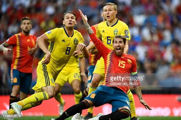 Spain's defender Sergio Ramos gestures beside Sweden's defender Ludwig Augustinsson and Sweden's midfielder Albin Ekdal during the UEFA Euro 2020...