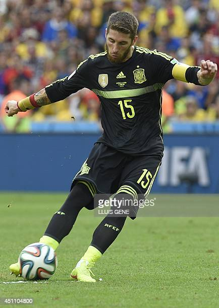 Spain's defender Sergio Ramos in action during a Group B match between Australia and Spain at the Baixada Arena in Curitiba during the 2014 FIFA...