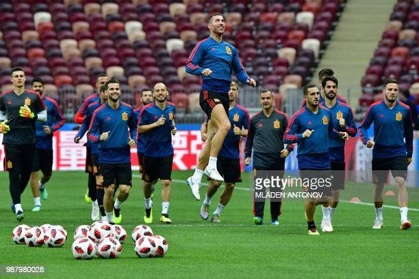 Spain's defender Sergio Ramos jumps as he takes part in a training session of the Spain's national football team at the Luzhniki Stadium in Moscow on...