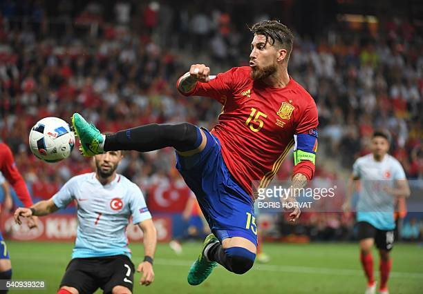 TOPSHOT Spain's defender Sergio Ramos plays the ball during the Euro 2016 group D football match between Spain and Turkey at the Allianz Riviera...