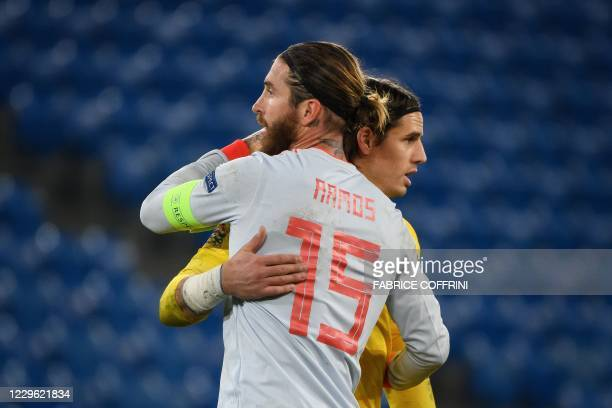 Spain's defender Sergio Ramos reacts with Switzerland's goalkeeper Yann Sommer at the end of the UEFA Nations League football match between...