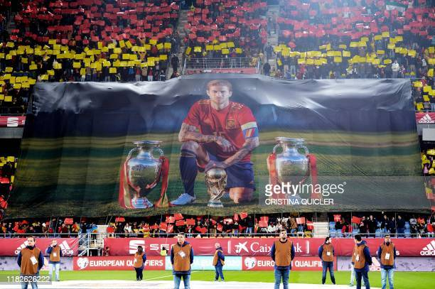 Spain's defender Sergio Ramos receives a tribute by being the player with more years in the Spanish selection during the Euro 2020 Group F football...