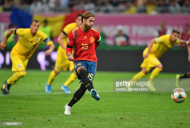 Spain's defender Sergio Ramos scores from the penalty spot during the Euro 2020 football qualification match between Romania and Spain in Bucharest,...