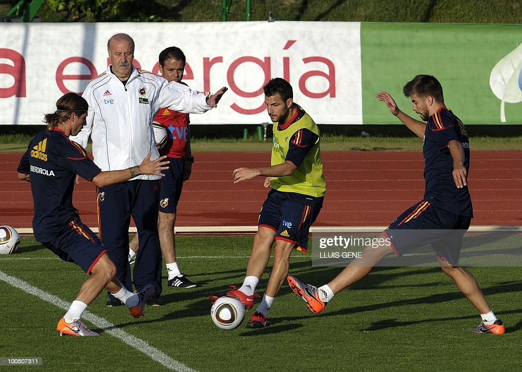 Spain's defender Sergio Ramos, Spain's coach Vicente del Bosque, Spain's midfielder Cesc Fabregas and Spain's defender Gerard Pique take part in a training session of the Spanish football team on May 25, 2010, at the Sports City of Las Rozas, near Madrid. Spain, among the favourites for the World Cup, which runs from June 11-July 11, face Switzerland, Honduras and Chile in Group H of the opening round.