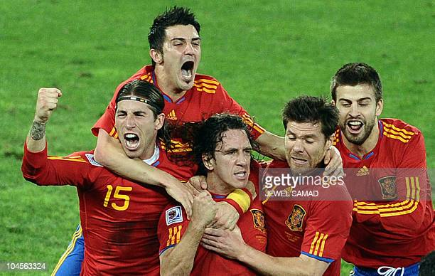 Spain's defender Sergio Ramos Spain's striker David Villa Spain's defender Carles Puyol Spain's midfielder Xabi Alonso Spain's defender Gerard Pique...