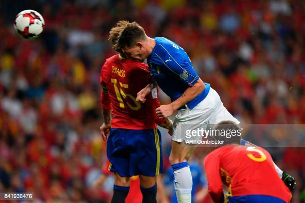 Spain's defender Sergio Ramos vies with Italy's forward Andrea Belotti during the World Cup 2018 qualifier football match Spain vs Italy at the...