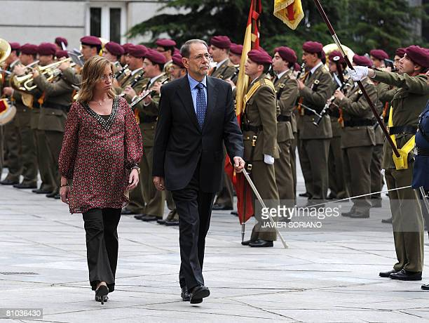 Spain's Defense Minister Carme Chacon and High Representative for the Common Foreign and Security Policy Javier Solana review the troops before a...