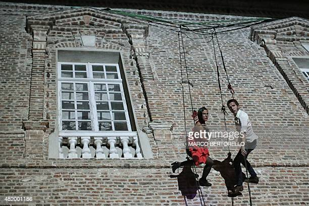 Spain's DelReves Company performs the vertical dance show Guateque at the Reggia of Venaria in Venaria Reale near Turin on July 25 2015 DelReves is a...