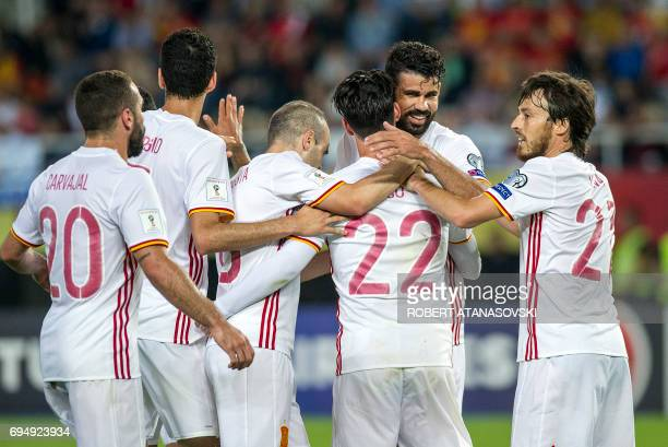 Spain's Diego Costa celebrates with teammates after scoring a goal during the FIFA World Cup 2018 qualification football match between Macedonia and...