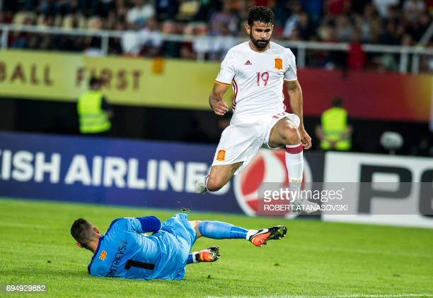 Spain's Diego Kosta jumps over with Macedonia's goalkeeper Stole Dimitrievski during the FIFA World Cup 2018 qualification football match between...