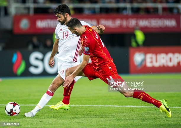 Spain's Diego Kosta vies with Macedonia's Kire Ristevski during the FIFA World Cup 2018 qualification football match between Macedonia and Spain at...
