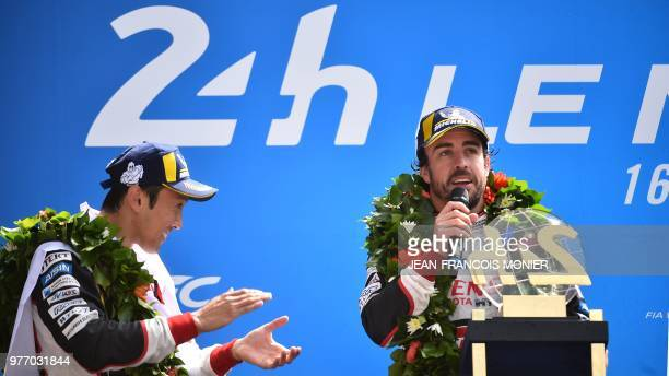 TOPSHOT Spain's driver Fernando Alonso celebrates next his teammates Japanese's Kazuki Nakajima after winning the 86th Le Mans 24hours endurance race...