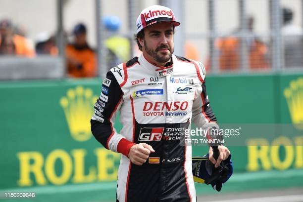 Spain's driver Fernando Alonso looks on after winning on his Toyota TS050 Hybrid LMP1 the 87th edition of the 24 Hours Le Mans endurance race on June...