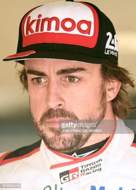 Spain's driver Fernando Alonso looks on in the pit after the free practice session of the 86th edition of the 24 Hours of Le Mans endurance race on...